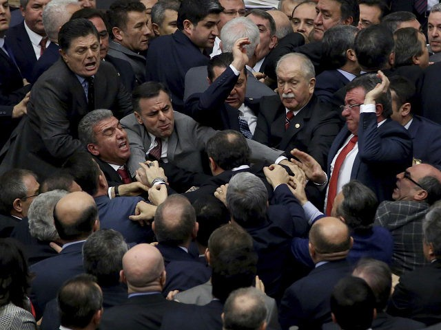 Ruling Justice and Development Party and main opposition Republican People's Party legislators scuffle in Turkey's parliament during deliberations over a controversial package of constitutional amendments that would greatly expand President Recep Tayyip Erdogan's powers, in Ankara, Turkey, Wednesday, Jan. 11, 2017. Lawmakers were seen pushing each other and exchanging blows during a round of voting on Wednesday. (AP Photo)