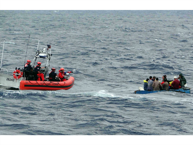 FILE - In this Jan. 4, 2016 file photo released by the U.S. Coast Guard, Coast Guard personnel arrive to assist Cuban migrants on a makeshift vessel in the Florida Straits. President Barack Obama announced Thursday, Jan. 12, 2017 he is ending a longstanding immigration policy that allows any Cuban …