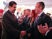 Venezuela's President Nicolas Maduro (C) shakes hands with Venezuela's new Vice-President Tarek El Aissami (R) during a meeting with ministers at 4F military fort in Caracas, Venezuela January 4, 2017. Miraflores Palace/Handout via REUTERS