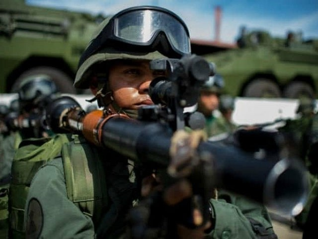 TOPSHOT - Venezuelan soldiers prepare to embark for military maneuvers at the port of La Guaira, Venezuela on January 8, 2017. / AFP / FEDERICO PARRA (Photo credit should read FEDERICO PARRA/AFP/Getty Images)