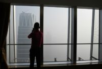 China's capital city started the year under a heavy blanket of grey smog, with a concentration of toxic particles 20 times higher than the maximal level recommended by the World Health Organization