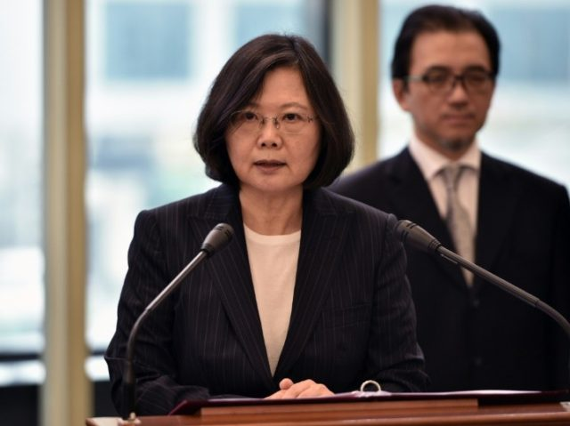 Taiwan President Tsai Ing-wen (left) speaks before departing from Taoyuan airport on January 7, 2017