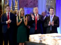 US President-elect Donald Trump along with his children (L-R) Eric, Ivanka and Donald Jr. arrive for a press conference on January 11, 2017 at Trump Tower in New York