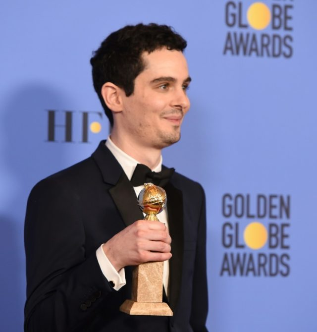"Writer/director Damien Chazelle, winner of Best Screenplay for ""La La Land"" poses in the press room during the 74th Annual Golden Globe Awards"