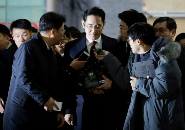 Lee Jae-yong (C), vice chairman of Samsung Electronics, arrives to be questioned as a suspect in a corruption scandal that led to the impeachment of President Park Geun-Hye, in Seoul, on January 12, 2017