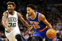 Derrick Rose (R) of the New York Knicks drives against Marcus Smart of the Boston Celtics during the first half, at TD Garden in Boston, Massachusetts, on January 18, 2017