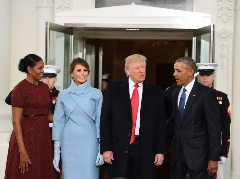 US President Barack Obama (R) and First Lady Michelle Obama (L) welcome Preisdent-elect Donald Trump (2nd-R) and his wife Melania to the White House on January 20, 2017