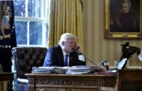 US President Donald Trump speaks on the phone with Russia's President Vladimir Putin from the Oval Office of the White House on January 28, 2017