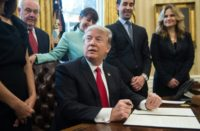 US President Donald Trump speaks before signing an executive order limiting regulation with small business leaders in the Oval Office at the White House on January 30, 2017