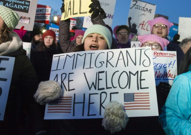 Demonstrators protest against US President Donald Trump and his administration's ban of travelers from seven countries by Executive Order, during a rally outside the US Supreme Court in Washington, DC, on January 30, 2017