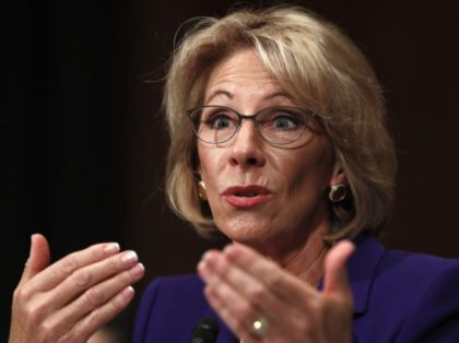 Journalists Rage over Betsy DeVos Visit to Catholic School that Calls Transgenderism 'Immoral'