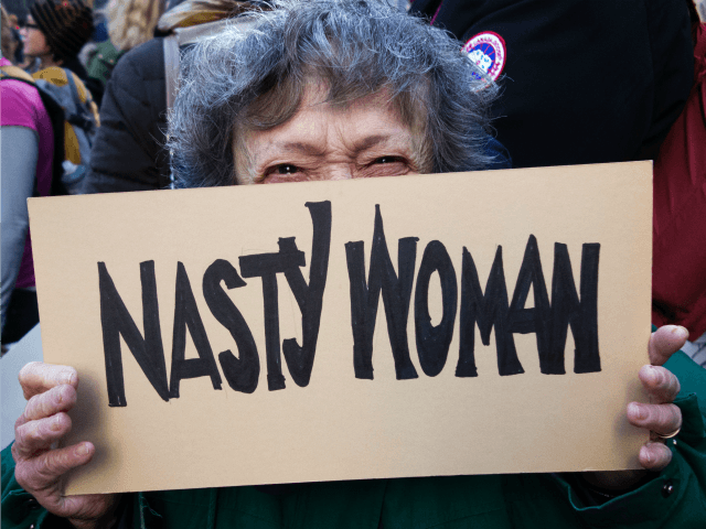 Protesters gather in midtown Manhattan as part of the Women's march vowing to resist US President Trump January 21, 2017 in New York. Hundreds of thousands of protesters spearheaded by women's rights groups demonstrated across the US to send a defiant message to US President Donald Trump. / AFP / …