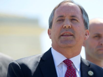 Texas Attorney General Ken Paxton, left, and Texas Solicitor General Scott Keller, right, meet with members of the media at the Supreme Court in Washington, Monday, April 18, 2016. The Supreme Court is taking up an important dispute over immigration that could affect millions of people who are living in …