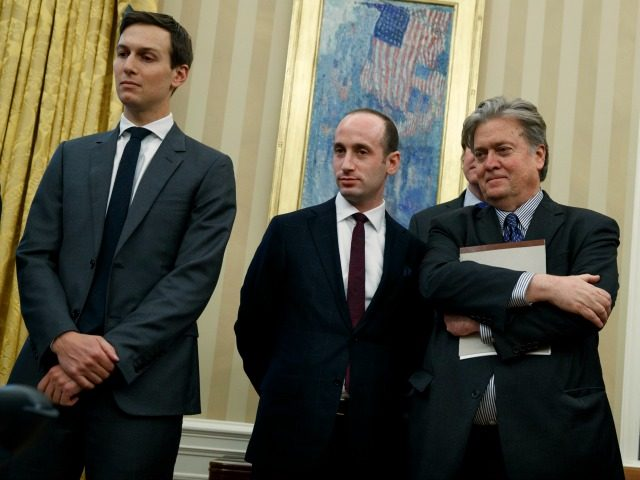 From left, Senior Adviser Jared Kushner, policy adviser Stephen Miller, and chief strategist Steve Bannon watches as President Donald Trump signs an executive order to withdraw the U.S. from the 12-nation Trans-Pacific Partnership trade pact agreed to under the Obama administration, Monday, Jan. 23, 2017, in the Oval Office of …