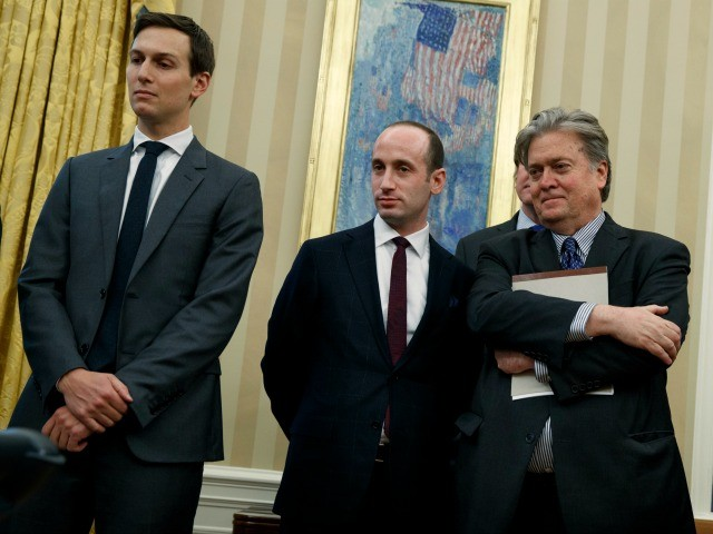 From left, Senior Adviser Jared Kushner, policy adviser Stephen Miller, and chief strategist Steve Bannon watches as President Donald Trump signs an executive order to withdraw the U.S. from the 12-nation Trans-Pacific Partnership trade pact agreed to under the Obama administration, Monday, Jan. 23, 2017, in the Oval Office of the White House in Washington. (AP Photo/Evan Vucci)