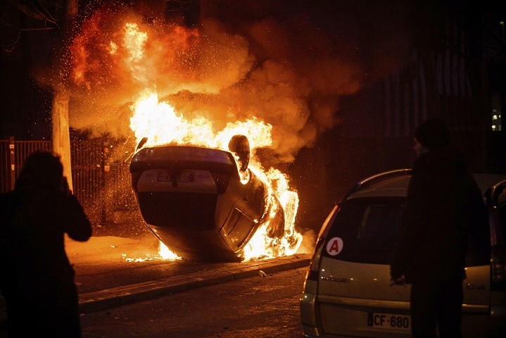 A car burns after a demonstration in Bobigny outside Paris, Saturday, Feb. 11, 2017. A peaceful demonstration protesting the alleged rape of a black youth by police has degenerated, with small groups setting at least one vehicle afire and throwing projectiles at police. (AP Photo/Aurelien Morissard)