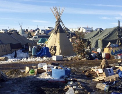 In this Thursday, Feb. 16, 2017, photo, debris is piled on the ground awaiting pickup by cleanup crews at the Dakota Access oil pipeline protest camp in southern North Dakota near Cannon Ball. The camp is on federal land, and authorities have told occupants to leave by Wednesday, Feb. 22 …