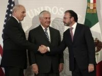 U.S. Secretary of State Rex Tillerson, center, smiles as Mexico's Foreign Relations Secretary Luis Videgaray, right, shakes hands with U.S. Homeland Security Secretary John Kelly at the Foreign Affairs Ministry in Mexico City, Thursday, Feb. 23, 2017. Mexico's mounting unease and resentment over President Donald Trump's immigration crackdown are looming …