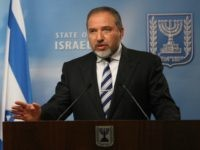 File - In this Tuesday, June 14, 2011 photo, Israeli Foreign Minister Avigdor Lieberman talks during a joint press conference with his German counterpart Guido Westerwelle, not seen, in Jerusalem. Israel's Justice Ministry filed an indictment of former foreign minister Avigdor Lieberman in a Jerusalem court on Sunday, charging him …