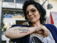 Israeli Arab Maysaloun Hamoud, director of the film 'Bar Bahar', poses with a tattoo bearing the title of her film during an interview with AFP in Tel Aviv on February 7, 2017. Hamoud's film, which has caused the director controversy and prompted death threats on social media against her, tackles …
