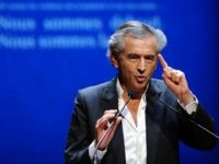 French philosopher and author Bernard-Henri Levy speaks during a commemoration ceremony for the victims of French jihadist gunman Mohamed Merah at the Halle aux Grains venue in Toulouse on March 19, 2015. Merah shot dead three soldiers in southern France in 2012 before killing three students and a teacher at …
