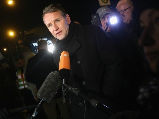 Bjoern Hoecke, co-head of the right-wing AfD (Alternative fuer Deutschland) political party in the state of Thuringia, speaks to reporters during an AfD vigil near the Chancellery for victims of the recent Berlin Christmas market terror attack on December 21, 2016 in Berlin, Germany. Right-wing groups are seeking to capitalize …