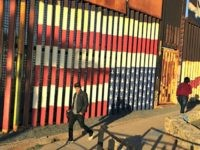 "People pass graffiti along the border structure in Tijuana, Mexico, Wednesday, Jan. 25, 2017. President Donald Trump moved aggressively to tighten the nation's immigration controls Wednesday, signing executive actions to jumpstart construction of his promised U.S.-Mexico border wall and cut federal grants for immigrant-protecting ""sanctuary cities."" (AP Photo/Julie Watson)"