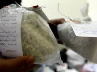 Syrian police show seized drugs and captagon pills at the Drug Enforcement Administration in the capital Damascus, on January 4, 2016. A string of major drug busts in Syria and Lebanon has drawn new attention to the trade in captagon, an illegal substance that has flourished in the chaos of …