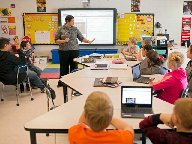 In this photo taken Feb. 12, 2015, sixth grade teacher Carrie Young guides her students through an exercise on their laptops as practice for the the Common Core State Standards Test in her classroom at Morgan Elementary School South in Stockport, Ohio. On Tuesday, Ohio becomes the first state to …