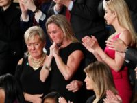"An emotional Carryn Owens, widow of widow of Chief Special Warfare Operator William ""Ryan"" Owens, on Capitol Hill in Washington, Tuesday, Feb. 28, 2017, as she was acknowledged by President Donald Trump during his address to a joint session of Congress. (AP Photo/Pablo Martinez Monsivais)"