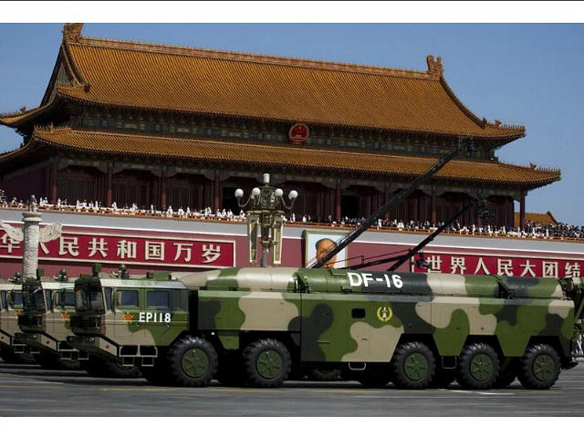 In this Sept. 3, 2015 photo, military vehicles carry DF-16 short-range ballistic missiles past Tiananmen Gate during a military parade to commemorate the 70th anniversary of the end of World War II in Beijing. A highly accurate Chinese ballistic missile capable of threatening U.S. and Japanese bases in Asia has made its latest appearance at recent Rocket Force drills. The medium-range DF-16 featured in a video posted on the Defense Ministry's website showing the missiles aboard their 10-wheeled mobile launch vehicles being deployed in deep forest during exercises over the just-concluded Lunar New Year holiday. (AP Photo/Andy Wong)