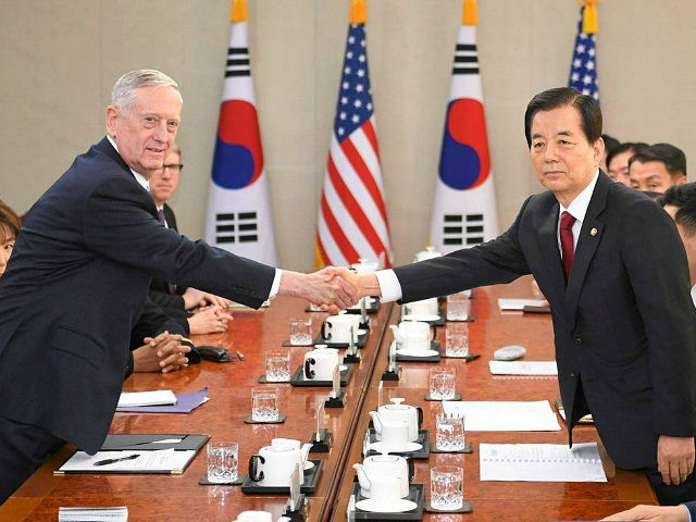 U.S. Defense Secretary James Mattis (L) and South Korean Defense Minister Han Min Koo shake hands before their talks in Seoul on Feb. 3, 2017. They focused on assessing North Korea's nuclear weapon and missile threats, discussing joint responses to any provocations and exploring ways to further strengthen their bilateral …