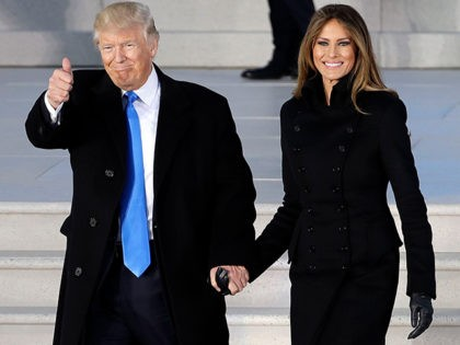 "This Jan. 19, 2017 file photo shows President-elect Donald Trump and his wife Melania Trump wearing a black suit at a pre-Inaugural ""Make America Great Again! Welcome Celebration"" at the Lincoln Memorial in Washington. Throughout the bruising presidential race, Mrs. Trump kept her look to typical wealthy socialite. Her blouses …"