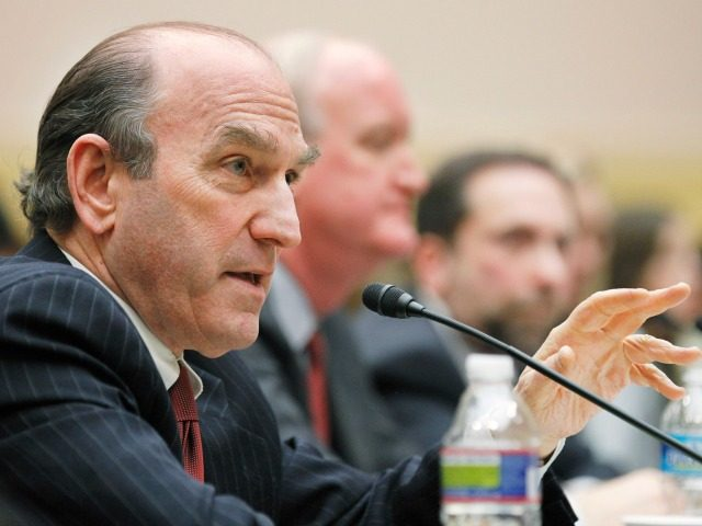 Elliott Abrams, senior fellow for Middle Eastern Studies, Council of Foreign Relations, left, accompanied by International Republican Institute President and former Assistant Secretary of State for Democracy, Human Rights, Labor Lorne Craner, center, and the Washington Institute for Near East Policy Executive Director Robert Satloff, testifies on Capitol Hill in …