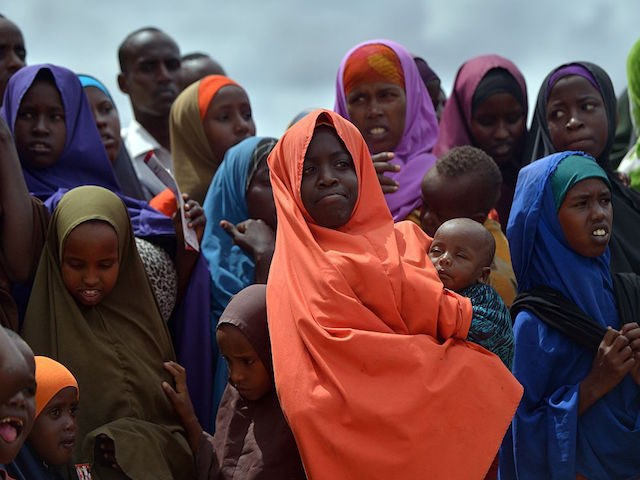 Refugees gather to watch the arrival of United Nations High Commissioner for Refugees Antonio Guterres at IFO-2 complex of the sprawling Dadaab refugee camp on May 8, 2015. Dadaab refugee camp currently houses some 350,000 people and for more than 20 years has been home to generations of Somalis who …
