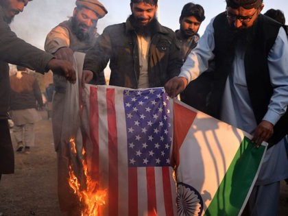 Pakistani supporters of the Jamaat-ud-Dawa (JuD) organisation burn Indian (R) and US flags after JuD leader, Hafiz Saeed was placed under house arrest by authorities in Islamabad on January 31, 2017. A Pakistani militant group held protests in the country's major cities after its leader, one of the alleged masterminds …