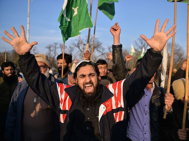 Pakistani supporters of the Jamaat-ud-Dawa (JuD) organisation shout slogans during a protest after JuD leader, Hafiz Saeed was placed under house arrest by authorities in Islamabad on January 31, 2017. A Pakistani militant group held protests in the country's major cities after its leader, one of the alleged masterminds of the 2008 Mumbai attacks, was placed under house arrest following years of foreign pressure. / AFP / Aamir QURESHI (Photo credit should read AAMIR QURESHI/AFP/Getty Images)