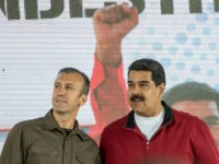 Venezuelan President Nicolas Maduro (R) and his vice-president Tareck El Aissami participate in a rally with workers of PDVSA state-owned oil company in Carcas January 31, 2017.  Maduro broadened the powers of his hardline number two in a decree Tuesday that analysts said showed he may be grooming him to take over as president. / AFP / JUAN BARRETO        (Photo credit should read JUAN BARRETO/AFP/Getty Images)