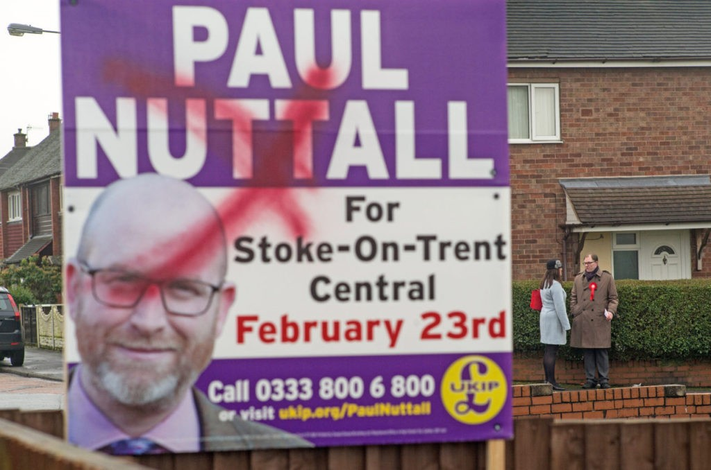 STOKE ON TRENT, ENGLAND - FEBRUARY 08: A defaced UKIP campaign poster ists in a garden as Labour's candidate for the Stoke-on-Trent Central by-election Gareth Snell and Stoke North MP Ruth Smeeth campaign on the doorsteps of homes in Bentilee on February 8, 2017 in Stoke on Trent, England. The Stoke-On-Trent central by-election has been called after sitting Labour MP Tristram Hunt resigned from his seat to be a museum director. The seat has always been a Labour stronghold but will see fierce competition from The United Kingdom Independence Party (UKIP) as they target people who voted for Brexit and the tradtional Labour working classes (Photo by Christopher Furlong/Getty Images)