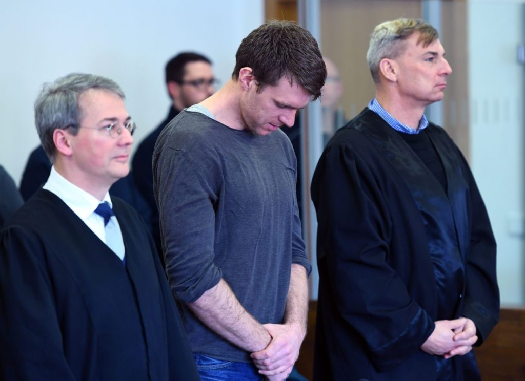 Politician of farright NPD party Maik Schneider stands between his lawyers in the court in Potsdam, eastern Germany, on February 9, 2017.  The German neo-Nazi was sentenced to eight years jail Thursday for an arson attack against a sports hall that was meant to house refugees. / AFP / dpa / Ralf Hirschberger / Germany OUT        (Photo credit should read RALF HIRSCHBERGER/AFP/Getty Images)