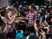 JAKARTA, INDONESIA - FEBRUARY 15: Basuki Tjahaja Purnama greets voters during his arrival on February 15, 2017 in Jakarta, Indonesia. Residents of Indonesia's capital went to the polls on Wednesday to vote for its new governor during an election marked by mass demonstrations against the incumbent governor Basuki Purnama Tjahaja, …