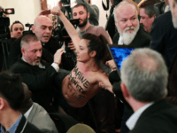 Topless Femen Activist Disrupts Speech by Marine Le Pen