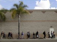 Home Depot volunteers for migrants (Gregory Bull / Associated Press)
