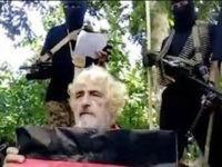 German hostage Jurgen Gustav Kantner kneels before his Islamic militant captors at an undisclosed location. (SITE Intel Group via AP)