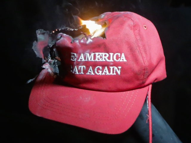 MAGA Make America Great Again hat burning at Berkeley (Elijah Nouvelage / Getty)