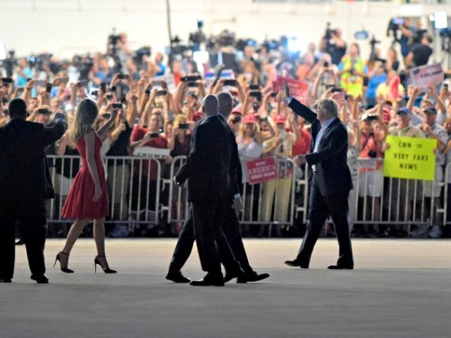 "President Donald Trump, second from right, and first lady Melania Trump, third from left, wave to the crowd following the ""Make America Great Again Rally"" at Orlando-Melbourne International Airport in Melbourne, Fla., Saturday, Feb. 18, 2017. (AP Photo/Susan Walsh)"