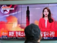"A man watches a TV news program reporting about North Korea's missile at the Seoul Train Station in Seoul, South Korea, Sunday, Feb. 12, 2017. The letters read ""The ruling and the opposition parties, denounce North Korea's missile launch. (AP Photo/Lee Jin-man)"