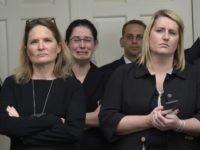Obama White House Staff crying (Susan Walsh / Associated Press)