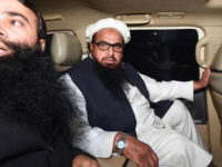 Pakistani leader of the Jamaat-ud-Dawa (JuD) organisation Hafiz Saeed (R) leaves in a car after being detained by police in Lahore, early on January 31, 2017. Pakistan has ordered the detention of the firebrand cleric linked to the 2008 Mumbai attacks which killed 166 people, according to a government directive seen by AFP late on January 30, 2017, after years of pressure to act. Hafiz Saeed, who heads the Jamaat-ud-Dawa (JuD) group and has a $10 million US bounty on his head, is to be placed under 'preventative detention', according the order from the interior ministry. / AFP / ARIF ALI (Photo credit should read ARIF ALI/AFP/Getty Images)
