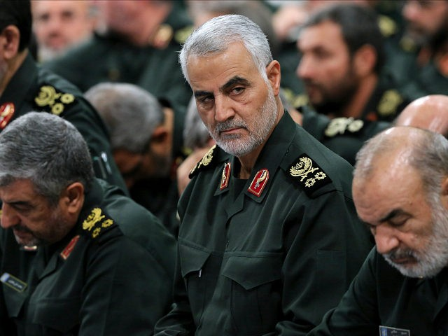 In this Sept. 18, 2016 photo released by an official website of the office of the Iranian supreme leader, Revolutionary Guard Gen. Qassem Soleimani, center, attends a meeting with Supreme Leader Ayatollah Ali Khamenei and Revolutionary Guard commanders in Tehran, Iran. As Saudi Arabia holds a naval drill in the …